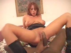 Hot redhead in black leather boots rides black cock