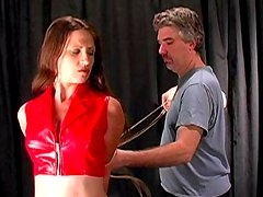 Babe in red latex being tied and humiliated