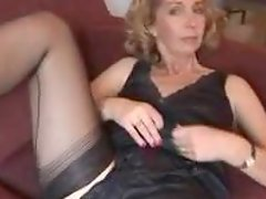 Sexy Matura lady gives a nice strip show in her nylon stockings