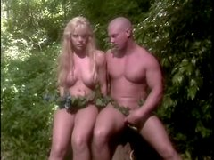 Finger banging a fake titty blonde chick in jungle