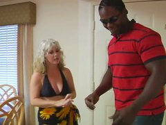 Curly blond whore Stacey seduces a black stud for a tough fuck