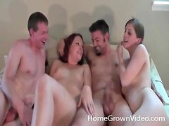 Amateur suck dicks and get tits sucked in foursome