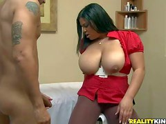 Plump masseuse Lady Spyce unbuttons her red blouse and then