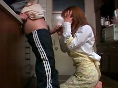 Horny Japanese housewife Riko Katase sucking dick in the kitchen