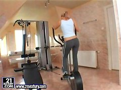 Horny Sophie Moone fingers and toys herself in gym