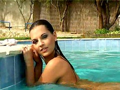 Gorgeous and zealous chick with nice boobs masturbates right in the pool