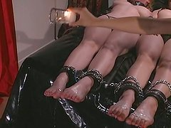 Hot mistress dripping wax on the chained feet