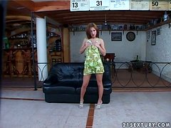 Afrodite Night the redhead hottie toys herself on a sofa