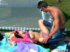 Buxom brunette is fond of having threesome right on the green lawn