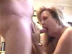 Plump and busty blondie squats down for sucking a delicious lollicock