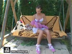 Stunning Marilyn Rose toys herself on the swing