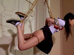 Skinny brunette is tied up and hanged down the ceiling