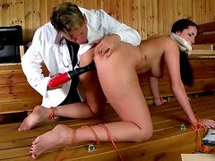 Bizarre patient enjoys being drilled in her cunt with a special tool