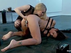 Smut and raw strap-on fucking. Lezdom electrosex. young woman onto slut fist shafting