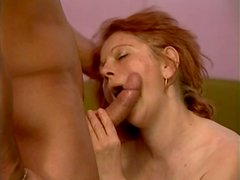 Sizzling red-haired granny Stella mouth fucks stiff young cock