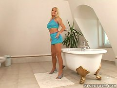 Adriana Malkova plays with her sweet pussy in the bathroom