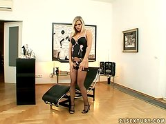 Sexy blonde Wivien shows her cute pussy and pounds it with a toy