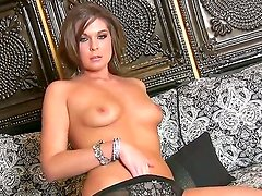 Adorable glamorous brunette Adrienne Manning with natural boobs in high heels gets naked and naughty