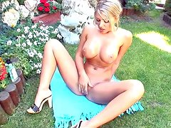 Arousing young looking adorable blonde babe with enormously big stunning