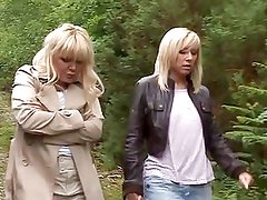 Two blonde MILFs suck off stranger in forest