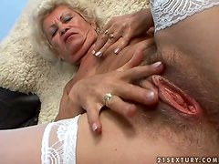 Effie the slutty old slut fingers and rides a cock in POV