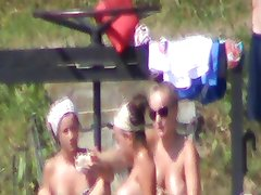 topless teen sunbathing