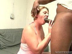 Fatty gives good head to a big black cock